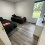 bedrooms with two spare beds and television